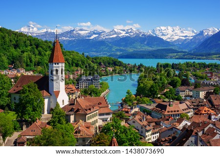 Historical Thun city and lake Thun with snow covered Bernese Highlands swiss Alps mountains in background, Canton Bern, Switzerland #1438073690