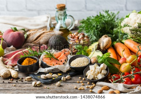Balanced nutrition concept for clean eating flexitarian mediterranean diet. Assortment of healthy food ingredients for cooking on a wooden kitchen table. #1438074866