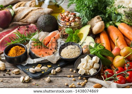 Balanced nutrition concept for clean eating flexitarian mediterranean diet. Assortment of healthy food ingredients for cooking on a wooden kitchen table. Royalty-Free Stock Photo #1438074869