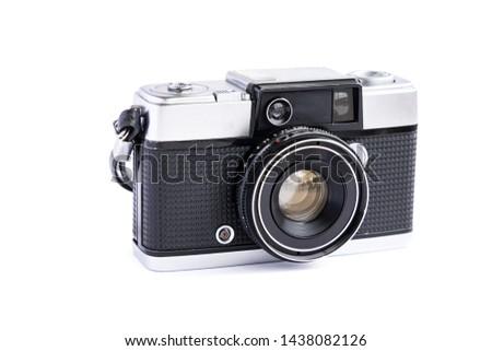 Vintage film camera isolated on white background. #1438082126