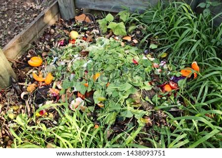 Compost heap in the garden. Eco conscious living concept image.