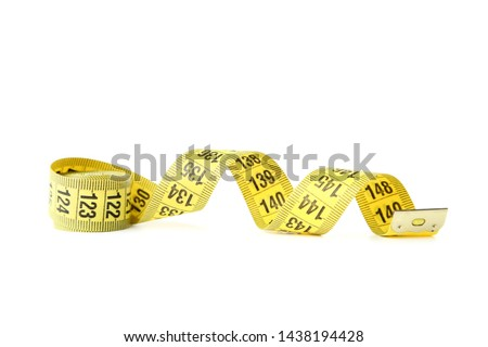Yellow measuring tape isolated on white background. #1438194428