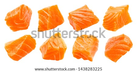 Salmon slices isolated on white background with clipping path, cubes of red fish, ingredient for sushi or salad, macro #1438283225