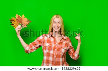 Autumn. Happy girl having fun with Leaf fall. Autumnal mood. Cheerful blonde woman holding gold leaf. Autumn time. Autumn sale. Fashion autumn girl with beauty face. Smiling woman playing with leaves. #1438329629