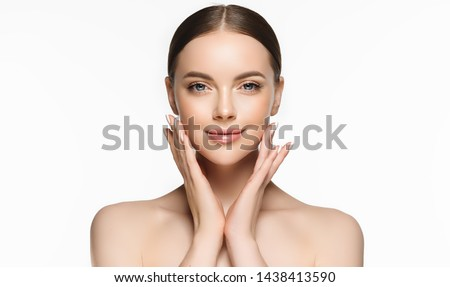 Beautiful young woman with clean fresh skin on face . Girl facial  treatment   . Cosmetology , beauty  and spa .  #1438413590