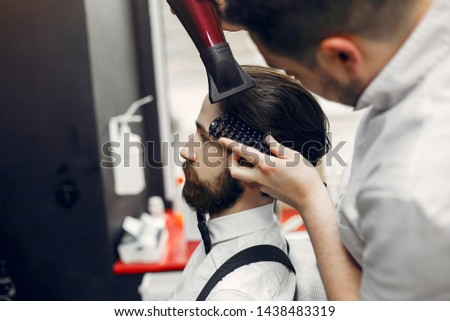 Man with a beard. Hairdresser with a client. #1438483319
