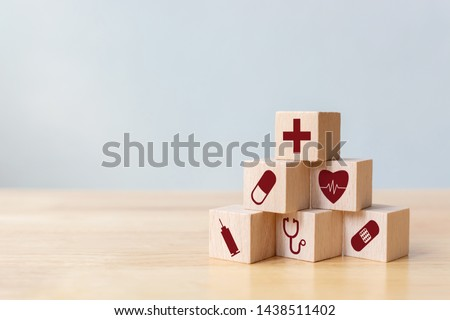 Wood block stacking with icon healthcare medical, Insurance for your health concept #1438511402