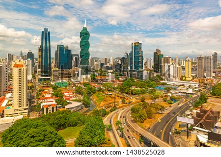 The cityscape of Panama city with its most famous skyscrapers in the financial district at sunrise with the morning traffic on the highway, Panama, Central America. #1438525028