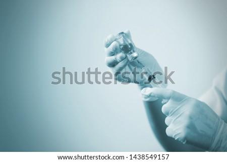 Doctor hand holding draw syringe and medicine bottle on white background, Medicine concept #1438549157