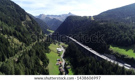 Aerial photo of Brenner Pass in Italian Passo del Brennero is a mountain road through Alps which forms border between Italy and Austria and is one of principal passes of Eastern Alpine range  #1438606997