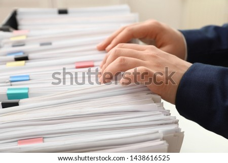 Woman working with documents in office, closeup #1438616525