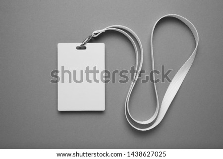 Empty layout layout. Common blank label name tag hanging on neck with thread. #1438627025