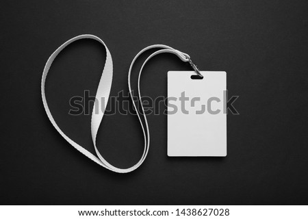 Blank badge mockup. Plain empty name tag mock up hanging on neck with string. #1438627028