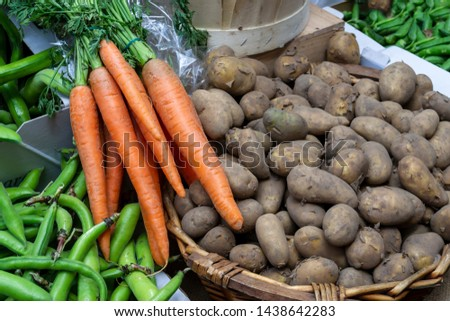 Homemade farmer's vegetable - carrot and potatoes at the market #1438642283