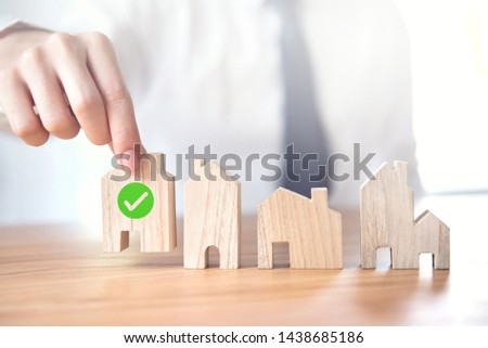 Businessman choosing house model with icon check mark, Choose what's the best, Planning buy Real Estate. #1438685186