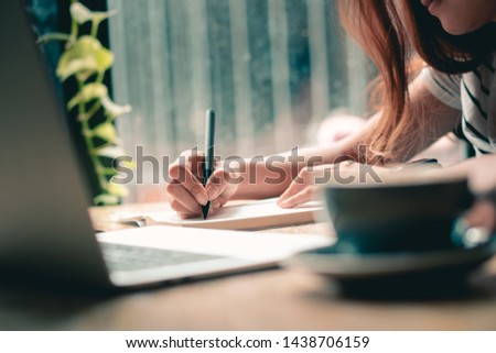 Hands writting close up.Working with document.Woman hands holding pen and listing to do list.Business with paperwork concept. #1438706159