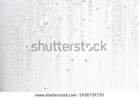 white isolated background water drops on the glass / wet window glass with splashes and drops of water and lime, texture autumn background Royalty-Free Stock Photo #1438739750