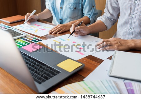 Creative UI designer teamwork meeting planning designing wireframe layout  application development mockup on smartphone screen for web mobile phone technology  #1438744637