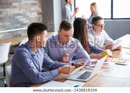 Colleagues during business meeting in office #1438818104