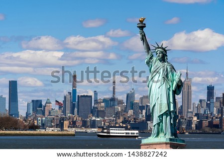 The Statue of Liberty over the Scene of New york cityscape river side which location is lower manhattan,Architecture and building with tourist concept #1438827242