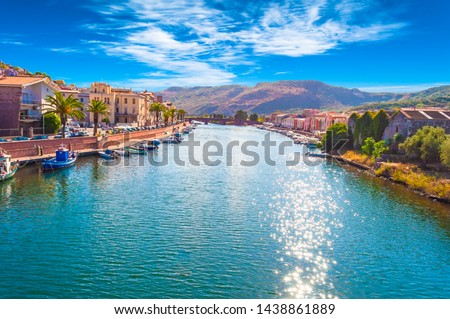 Old village of Bosa on the river Temo, in Sardinia, in a sunny and cloudy day #1438861889