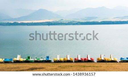 Pedal boats on the beach of Liptovska Mara lake, Slovakia #1438936157