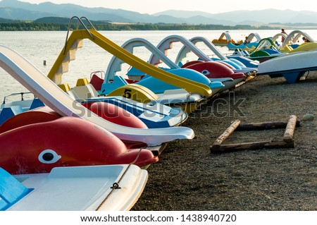 Pedal boats on the beach of Liptovska Mara lake, Slovakia #1438940720