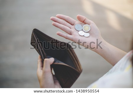 businesswoman on have money unemployed and bankrupt looks into his empty wallet. Stress crisis, unemployed businessmen are waiting for new jobs, recession situation and hopelessness crisis concept. Royalty-Free Stock Photo #1438950554
