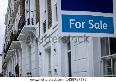 Estate agent 'for sale' sign on attractive London street