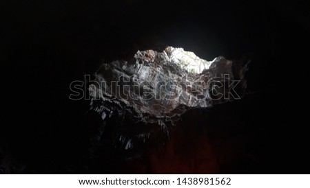 borra caves Close up of colorful natural formation of stalactites and stalagmites in araku valley #1438981562