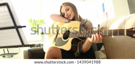 Beautiful Female Musician Art Inspiration Concept. Caucasian Girl at House Lesson. Beautiful Woman Composing Melody Playing Chords on Acoustic Guitar. Musical Performer Person Leisure #1439041988