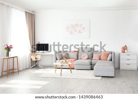 Modern living room interior with comfortable sofa #1439086463