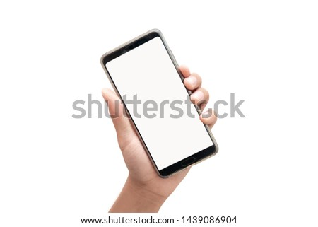 Man holding mobile phone with blank screen isolated on white background. #1439086904