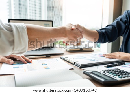 Business handshake after agreement meeting or negotiation finishing up dealing project, partnership approval and deal concept #1439150747