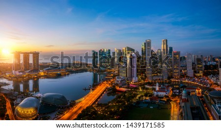 Singapore city and sunrise sky in harbour side view of hotel windows #1439171585