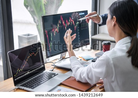 Business team investment working with computer, planning and analyzing graph stock market trading with stock chart data, business financial investment and technology concept. #1439212649