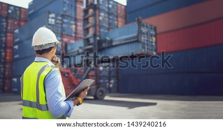 Foreman control loading containers box from cargo freight ship for import export, Business logistic concept, Import and export concept #1439240216