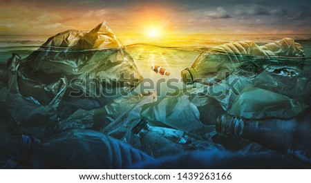 Fish swims among plastic bag ocean pollution. Environment concept #1439263166