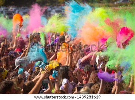 """Lodz, Poland - July 29, 2018: People playing at the festival of colors in the place """"Łódzkie błonie"""" #1439281619"""