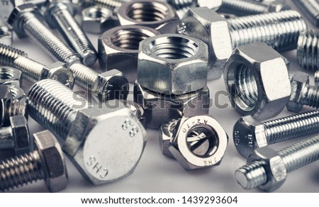 Bolts nuts screw washer zinc heap chrome Royalty-Free Stock Photo #1439293604