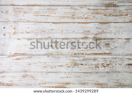 White wooden floorboards. Distressed worn floorboard background painted white Royalty-Free Stock Photo #1439299289