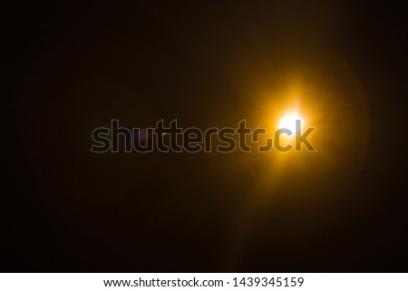 Abstract Natural Sun flare on the black #1439345159