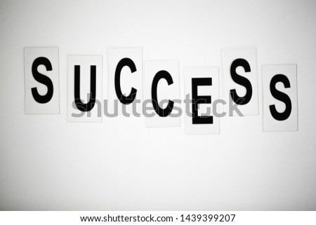 Success word written on white table. Copy space #1439399207