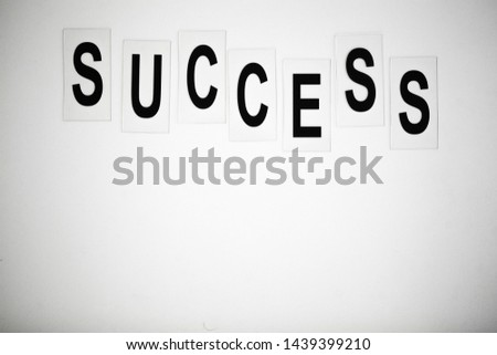 Success word written on white table. Copy space #1439399210