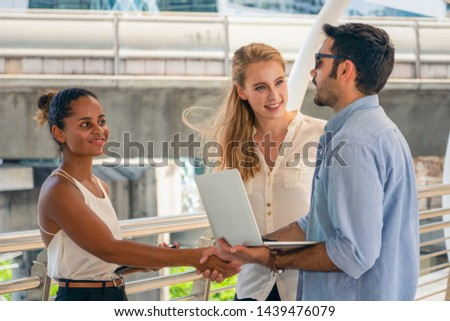diversity of business people or university students having hands shake outdoor #1439476079