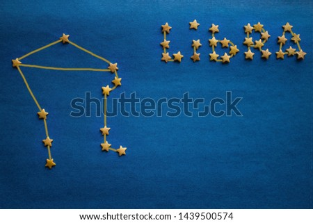 Zodiac sign, eastern horoscope, astrological prediction. On a blue background a small star is lined with a constellation of Libra. The picture is made by the author.