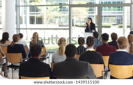 Front view of young Asian female executive doing speech in conference room #1439515100