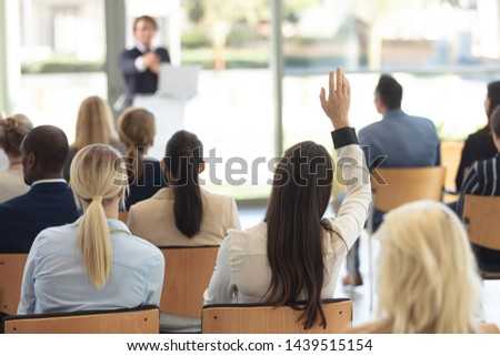 Front view of mature Caucasian male executive doing speech in conference room #1439515154