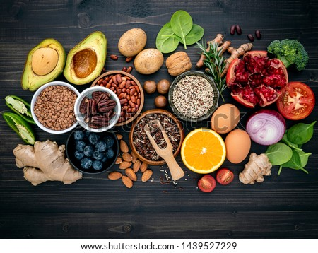 Ingredients for the healthy foods selection. The concept of healthy food set up on wooden background. #1439527229