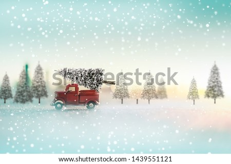 Christmas tree on a red toy car